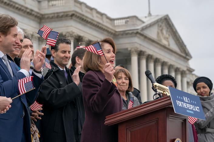"""Speaker of the House Nancy Pelosi, D-Calif., and House Democrats rally ahead of passage of H.R. 1, """"The For the People Act,"""" at the Capitol in Washington, Friday, March 8, 2019.  (Photo: J. Scott Applewhite/AP)"""