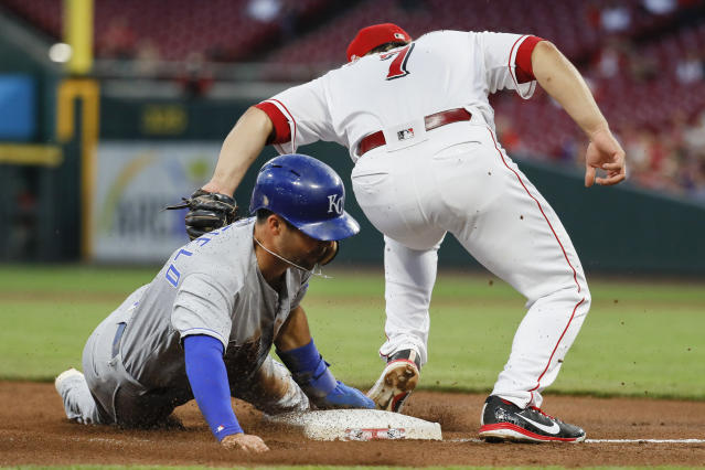 Kansas City Royals' Whit Merrifield, left, steals third against Cincinnati Reds third baseman Eugenio Suarez during the third inning of a baseball game Wednesday, Sept. 26, 2018, in Cincinnati. (AP Photo/John Minchillo)