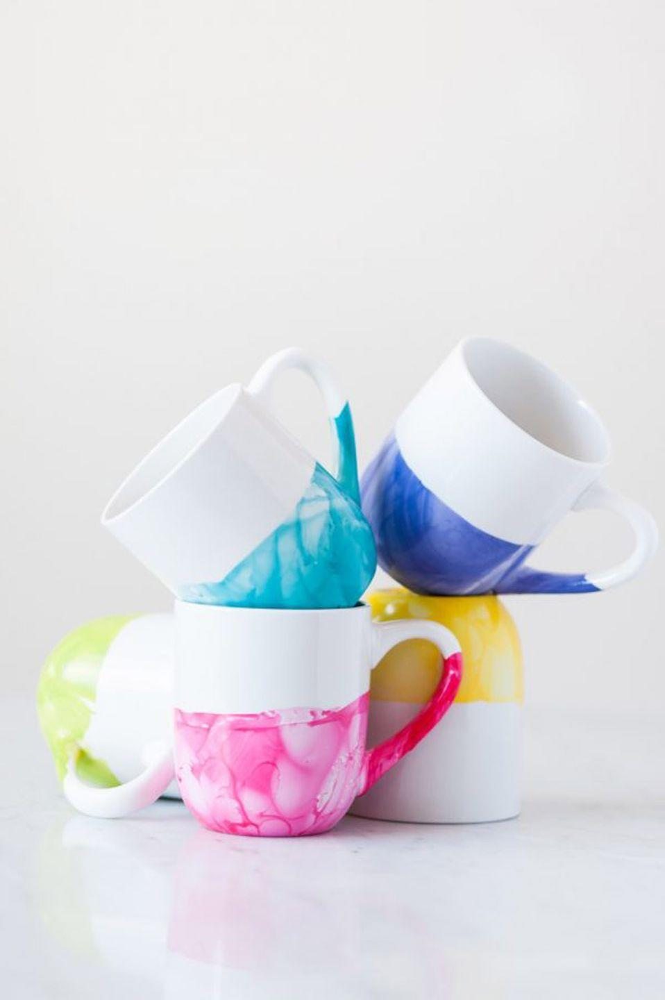 """<p>Let kids make a little bit of a mess with these coffee mugs. As beautiful as the marbling looks, it's actually incredibly easy to create.</p><p><strong>Get the tutorial at <a href=""""https://thesweetestoccasion.com/2015/08/diy-marble-dipped-mugs/"""" rel=""""nofollow noopener"""" target=""""_blank"""" data-ylk=""""slk:The Sweetest Occasion"""" class=""""link rapid-noclick-resp"""">The Sweetest Occasion</a>.</strong></p><p><strong>What you'll need:</strong> <em>paintable ceramic mugs ($20 for 4, <a href=""""https://www.amazon.com/Perfect-Mug-Unfinished-Paint-Potamus/dp/B019KV7QXI"""" rel=""""nofollow noopener"""" target=""""_blank"""" data-ylk=""""slk:amazon.com"""" class=""""link rapid-noclick-resp"""">amazon.com</a>)</em></p>"""