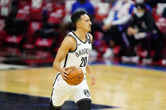 Nets guard Landry Shamet brings the ball up court during a game against the 76ers on Feb. 6, 2021.