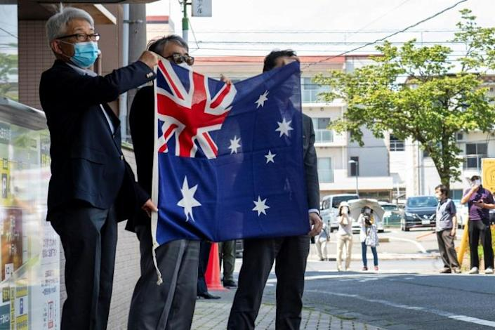 Hotel staff greeted the team with an Australian flag on arrival in Ota