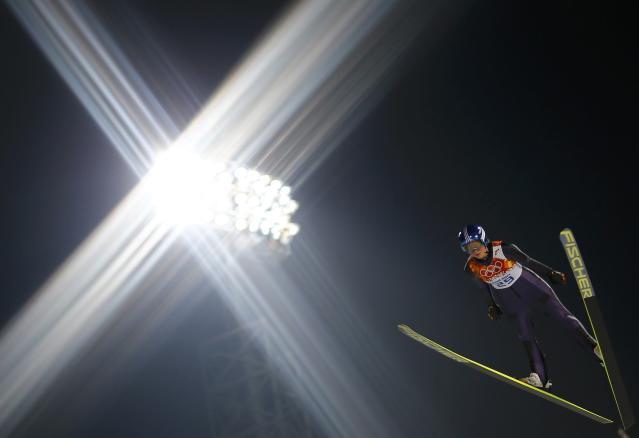Germany's Carina Vogt soars through the air during her trial jump in the women's ski jumping individual normal hill event at the Sochi 2014 Winter Olympic Games, at the RusSki Gorki Jumping Centre, in Rosa Khutor February 11, 2014. REUTERS/Kai Pfaffenbach (RUSSIA - Tags: OLYMPICS SPORT SKIING)