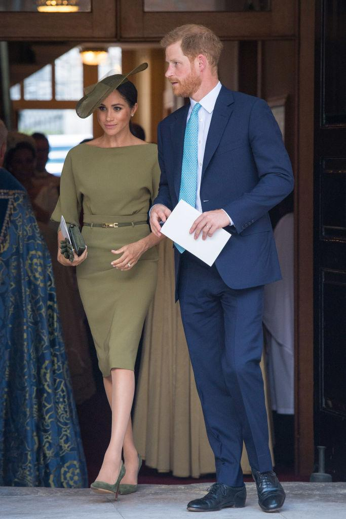 <p>Markle wore a soft olive green coloured dress with belted detail by Ralph Lauren for Prince Louis's christening in July 2018. <em>(Image via Getty Images)</em></p>