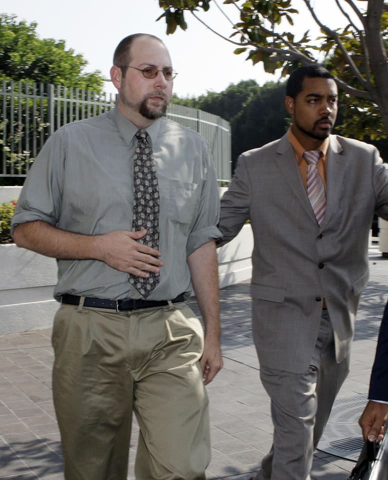 """Christopher Chaney, 35, of Jacksonville, Fla., left, arrives at federal court in Los Angeles Tuesday, Nov. 1, 2011. Chaney was indicted last month on 26 counts, including unauthorized access to a computer and wiretapping, including allegedly hacking into the email accounts of celebrities such as Scarlett Johansson, whose nude photos appeared on the Internet. Chaney was arrested as part of a yearlong investigation of celebrity hacking that authorities dubbed """"Operation Hackerazzi."""" (AP Photo/Reed Saxon)"""