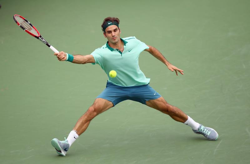 Roger Federer of Switzerland hits a return in the win over David Ferrer of Spain during the finals of the Western & Southern Open on August 17, 2014 at the Linder Family Tennis Center in Cincinnati, Ohio