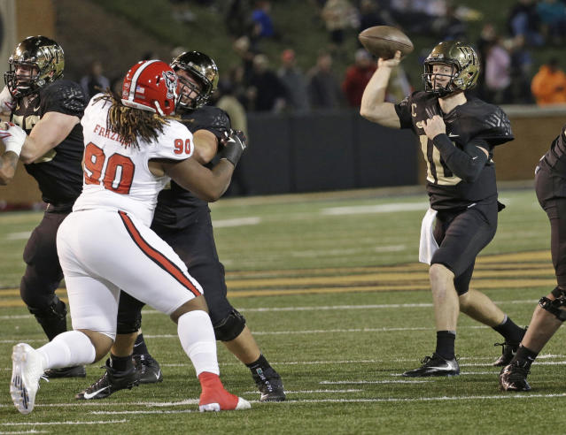 "Wake Forest's <a class=""link rapid-noclick-resp"" href=""/ncaaf/players/243425/"" data-ylk=""slk:John Wolford"">John Wolford</a> (10) throws a pass against North Carolina State during the second half of an NCAA college football game in Winston-Salem, N.C., Saturday, Nov. 18, 2017. (AP Photo/Chuck Burton)"