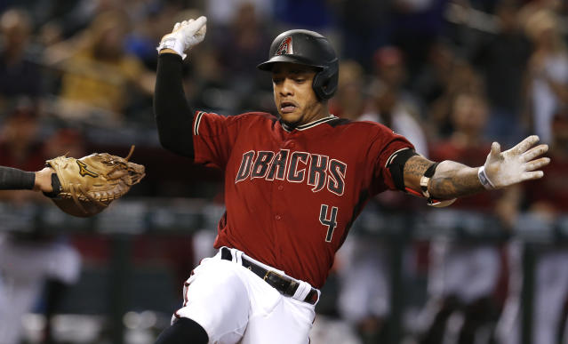 Arizona Diamondbacks' Ketel Marte crosses home plate after hitting an inside-the-park home run against the Washington Nationals in the third inning during a baseball game, Sunday, Aug. 4, 2019, in Phoenix. (AP Photo/Rick Scuteri)