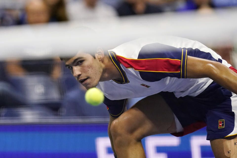 Carlos Alcaraz, of Spain, eyes his return to Felix Auger-Aliassime, of Canada, during the quarterfinals of the U.S. Open tennis tournament Tuesday, Sept. 7, 2021, in New York. (AP Photo/Frank Franklin II)