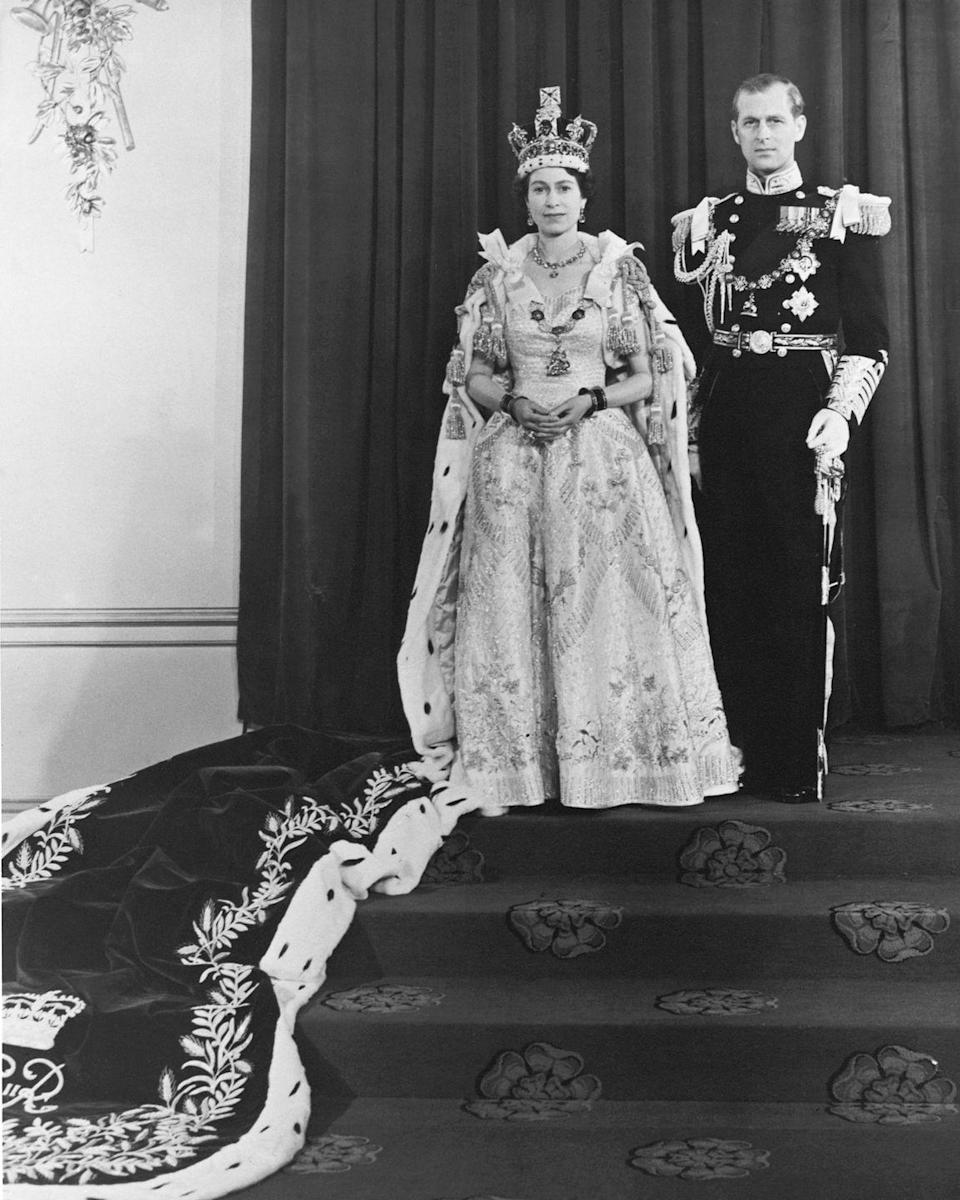 "<p>For her coronation day, the Queen had an elaborate gown designed by Norman Hartnell. The dress was made of a white duchess satin, and <a href=""https://www.royal.uk/50-facts-about-queens-coronation-0"" rel=""nofollow noopener"" target=""_blank"" data-ylk=""slk:was embroidered with"" class=""link rapid-noclick-resp"">was embroidered with</a> floral emblems representing the commonwealth countries in a gold and silver thread. </p>"