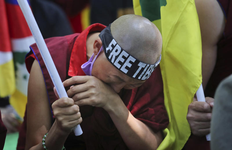 An exile Tibetan breaks down during a march to mark the 60th anniversary of the March 10, 1959 Tibetan Uprising Day, in New Delhi, India, Sunday, March 10, 2019. The uprising of the Tibetan people against the Chinese rule was brutally quelled by Chinese army forcing the spiritual leader the Dalai Lama and thousands of Tibetans to come into exile. Every year exile Tibetans mark this day as the National Uprising Day. (AP Photo/Manish Swarup)