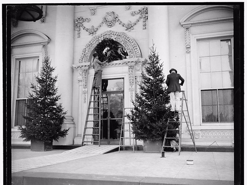 Installing the wreath at the White House entrance, 1937
