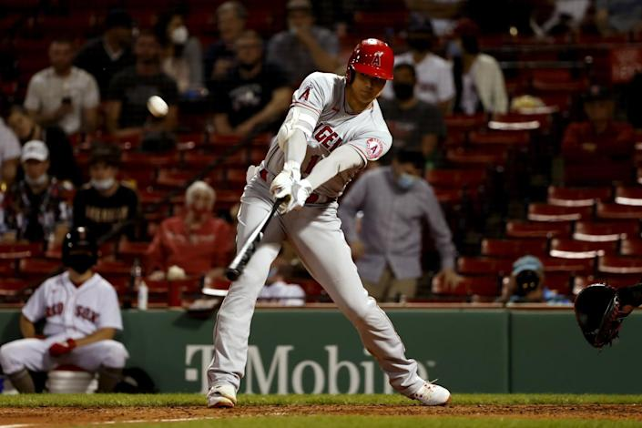 The Angels' Shohei Ohtani reaches out to hit a solo home run during the sixth inning May 14, 2021.