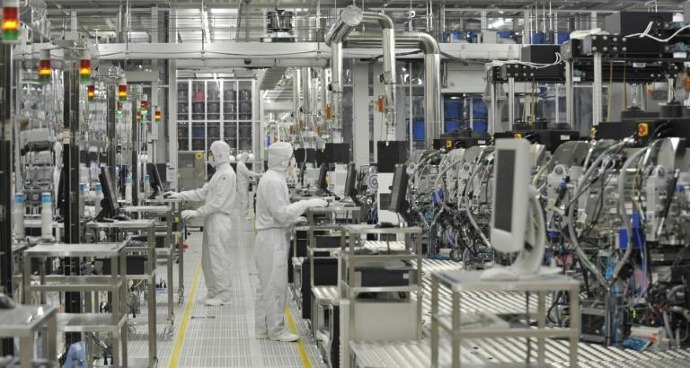 Workers at Japan's microprocessor maker Renesas work at the company's factory in Hitachinaka, Ibaraki prefecture