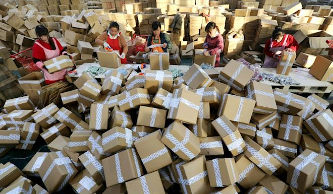 Staff at a sorting centre in China's Jiangsu province prepare delivery packages from online orders. Complaints have risen by internet shoppers as the trend for online buying continues. Photo: AFP