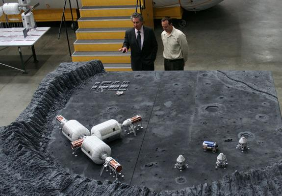 Space entrepreneur Robert Bigelow (left) discusses layout plans of the company's lunar base with Eric Haakonstad, one of the Bigelow Aerospace lead engineers.
