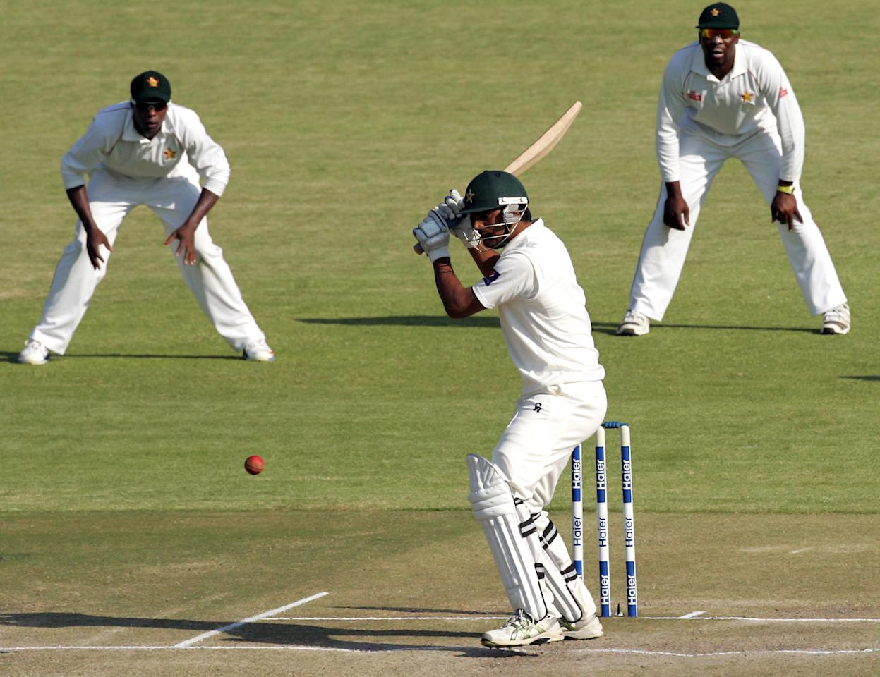 Pakistan's batsman Rahat Ali plays a shot on the fourth day of the first test cricket match between Pakistan and Zimbabwe at the Harare Sports Club on September 6, 2013. AFP PHOTO / JEKESAI NJIKIZANA        (Photo credit should read JEKESAI NJIKIZANA/AFP/Getty Images)