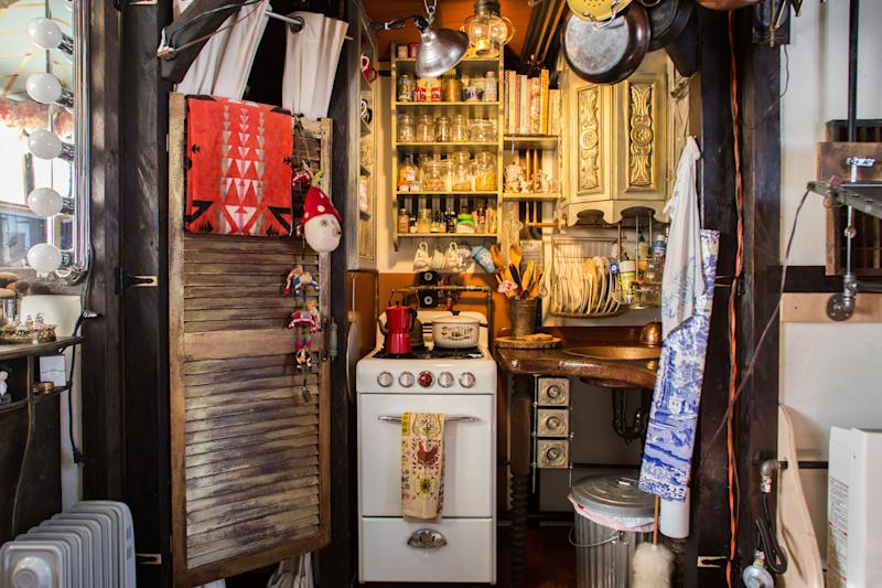 The vintage Magic Chef oven is the main feature of the tiny home kitchen. Chloe and Brandon curated the space so it would be easy to cook homemade meals.