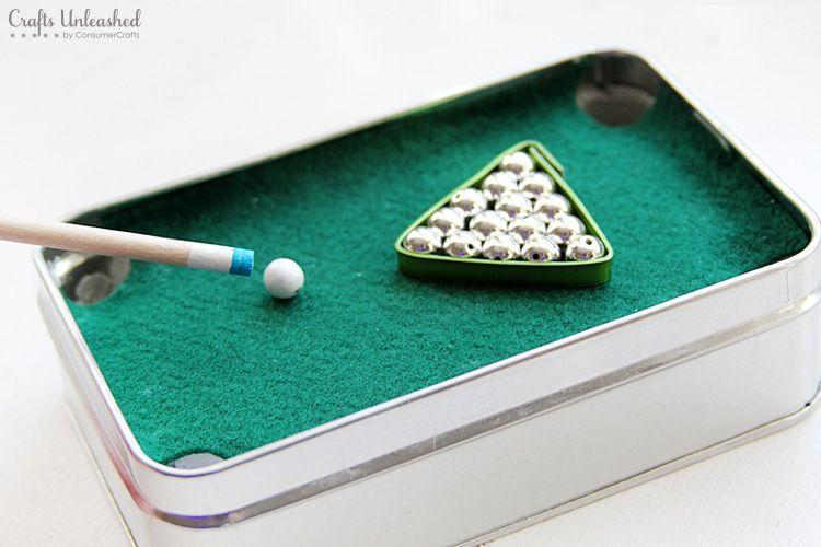 """<p>For the dad who is always seeking a pool table, this tiny tin version will keep him entertained when he's itching for a cue. </p><p><strong>Get the tutorial at <a href=""""http://blog.consumercrafts.com/seasonal/pool-diy-gift-for-dad/"""" rel=""""nofollow noopener"""" target=""""_blank"""" data-ylk=""""slk:Crafts Unleashed"""" class=""""link rapid-noclick-resp"""">Crafts Unleashed</a>.</strong></p><p><strong><a class=""""link rapid-noclick-resp"""" href=""""https://www.amazon.com/s/ref=nb_sb_noss_2?url=search-alias%3Daps&field-keywords=green+felt&tag=syn-yahoo-20&ascsubtag=%5Bartid%7C10050.g.645%5Bsrc%7Cyahoo-us"""" rel=""""nofollow noopener"""" target=""""_blank"""" data-ylk=""""slk:SHOP FELT"""">SHOP FELT</a></strong> </p>"""