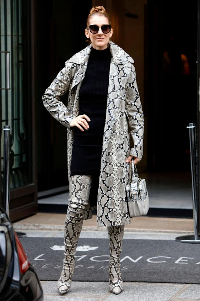 <p>In a reptile coat, thigh-high boots and bag while leaving the Hotel Royal Monceau in Paris. </p>