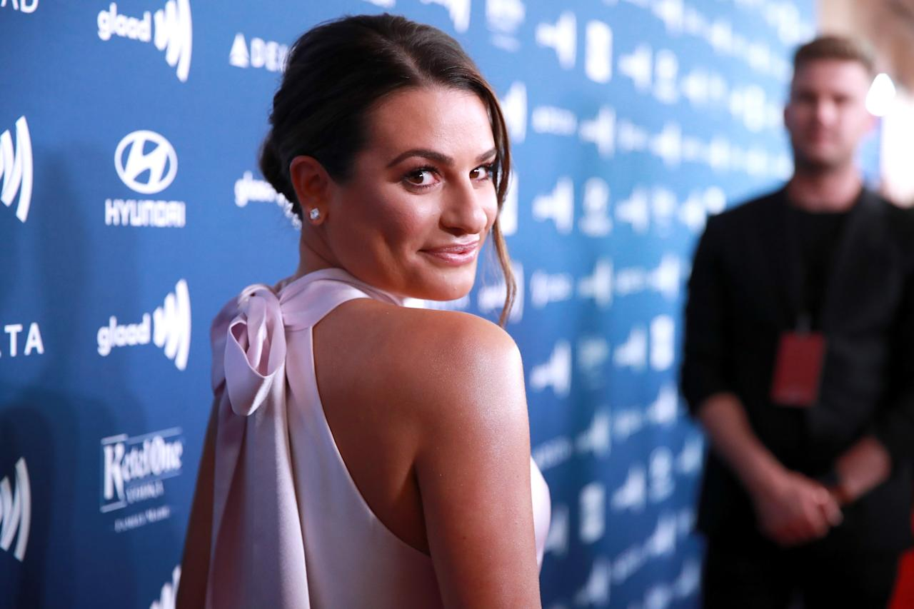 <p>Parted to the side and smoothed tight to the head, Lea Michele's low bun is a can't-lose classic. A loose curl at the front adds a finishing touch.</p>