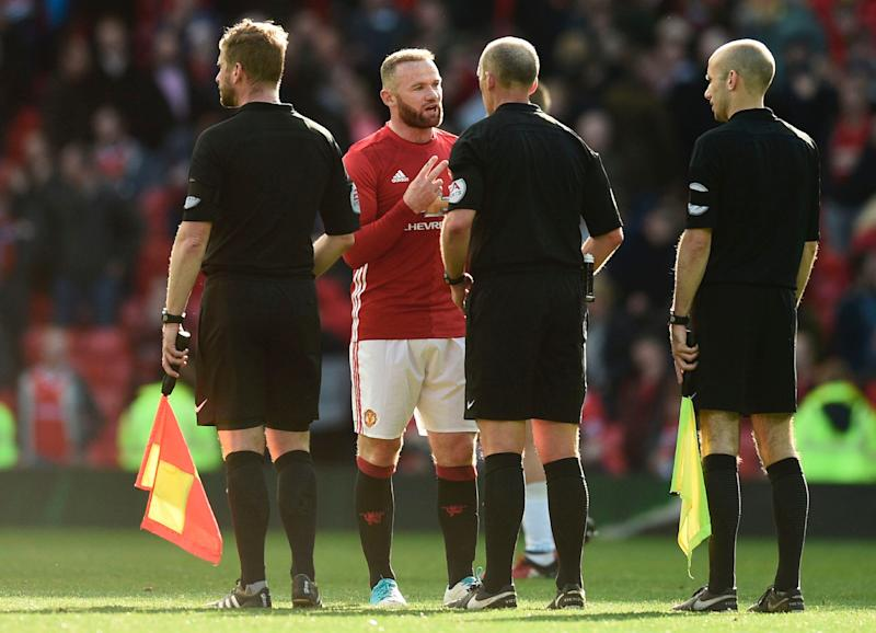 Wayne Rooney beards the ref at Old Trafford - Credit: OLI SCARFF/AFP/Getty Images