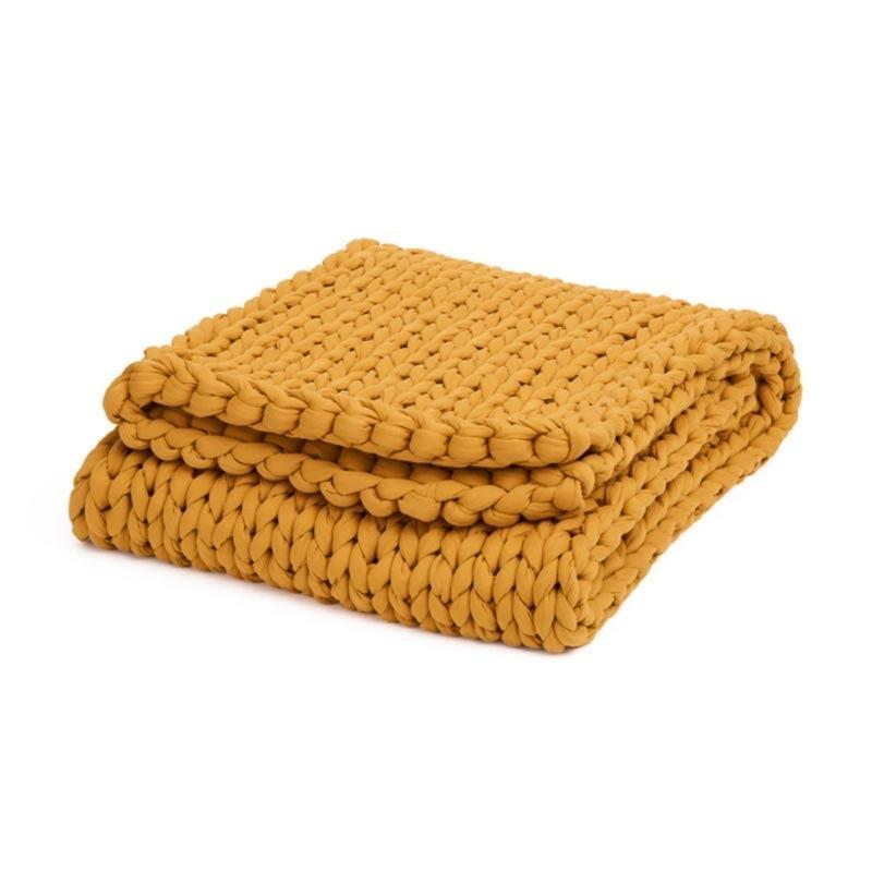 """Sometimes the best gift you can give is sleep, and if there's anything that can lull your loved one to bed, it's this <a href=""""https://www.glamour.com/gallery/best-weighted-blankets?mbid=synd_yahoo_rss"""" rel=""""nofollow noopener"""" target=""""_blank"""" data-ylk=""""slk:weighted blanket"""" class=""""link rapid-noclick-resp"""">weighted blanket</a>. The Napper is hand-knit to evenly distribute weight without trapping heat and comes in three different weights (15, 20, and 25 pounds). $250, Bearaby. <a href=""""https://bearaby.com/products/the-napper"""" rel=""""nofollow noopener"""" target=""""_blank"""" data-ylk=""""slk:Get it now!"""" class=""""link rapid-noclick-resp"""">Get it now!</a>"""