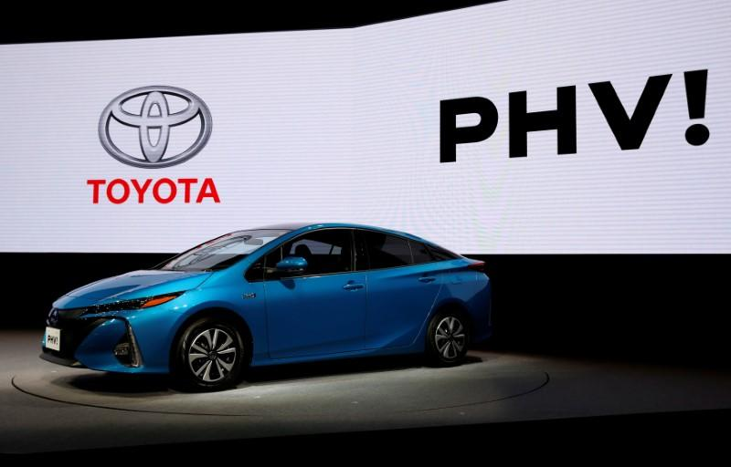 Toyota Motor Corp. displays the company's Prius PHV Plug-in-Hybrid vehicle during an event to mark the launch of the car in Japan, in Tokyo