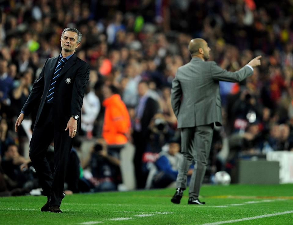 BARCELONA, SPAIN - APRIL 28: Jose Mourinho (L) of Inter Milan looks on during the UEFA Champions League Semi Final Second Leg match between Barcelona and Inter Milan at Camp Nou on April 28, 2010 in Barcelona, Spain.  (Photo by Michael Regan/Getty Images)