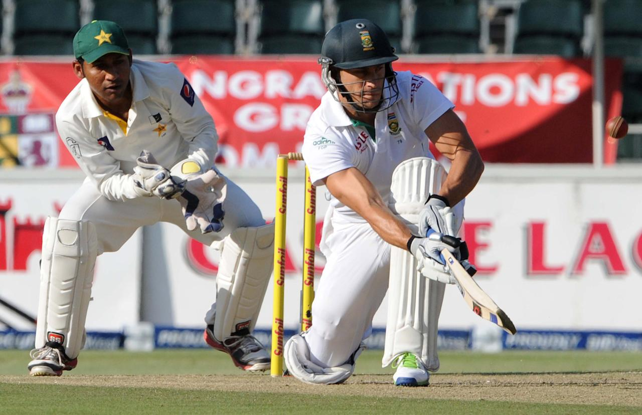JOHANNESBURG, SOUTH AFRICA - FEBRUARY 01: (SOUTH AFRICA) Sarfraz Ahmed of Pakistan looks on as Faf du Plessis of South Africa paddles the ball down to fine leg  during day 1 of the first Test match between South Africa and Pakistan at Bidvest Wanderers Stadium on February 01, 2013 in Johannesburg, South Africa. (Photo by Lee Warren/Gallo Images/Getty Images)