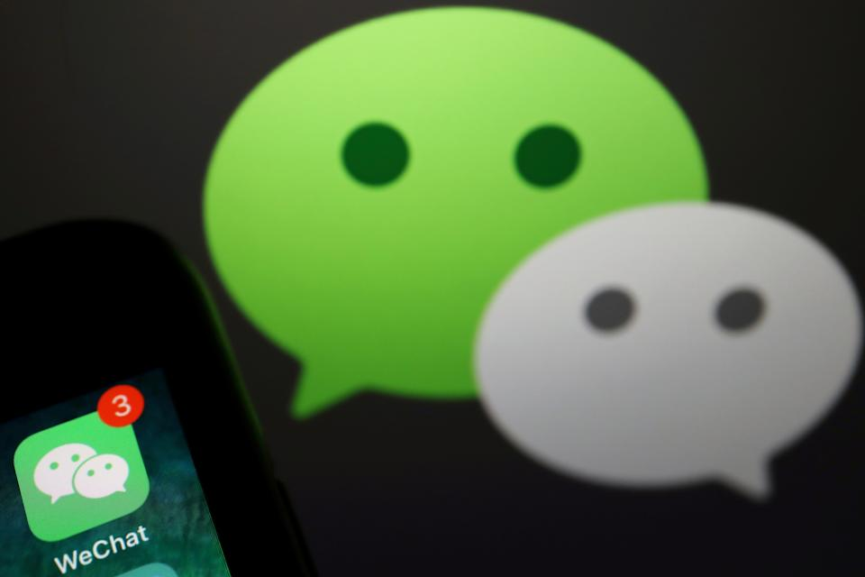 The messenger app WeChat is seen next to its logo in this illustration picture taken August 7, 2020. REUTERS/Florence Lo/Illustration