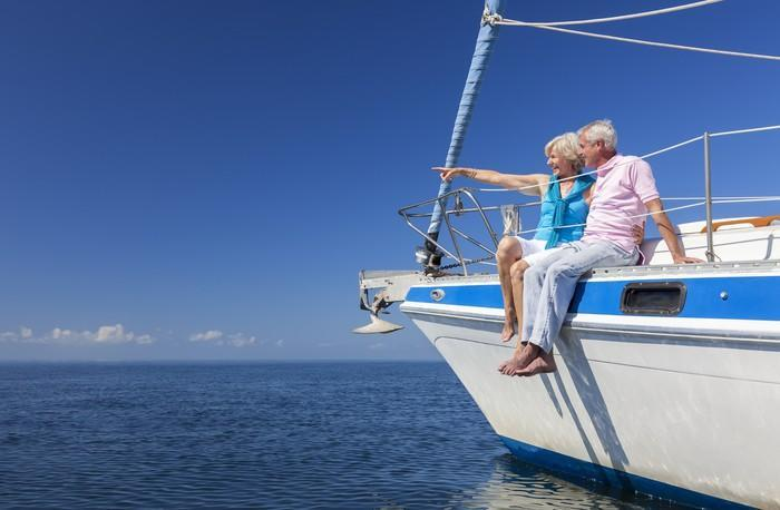 Senior couple on sailboat looking out at ocean