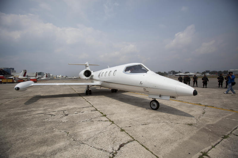 A plane carrying the former president of Guatemala, Alfonso Portillo, prepares to take off at the airport in Guatemala City, Friday, May 24, 2013. Portillo was extradited to the United States to face charges of laundering $70 million in Guatemalan funds through U.S. bank accounts. (AP Photo)