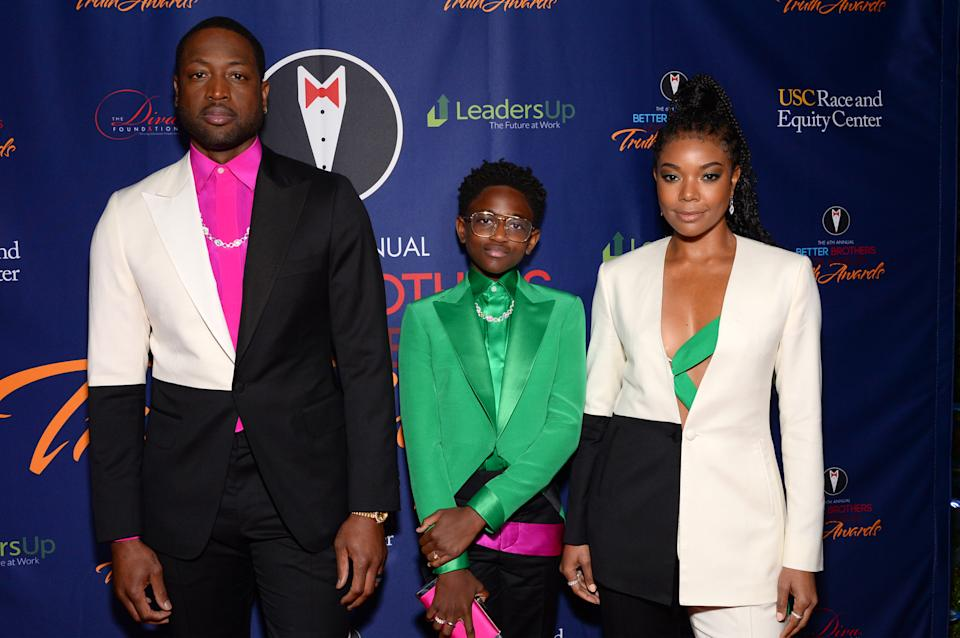 Dwyane Wade, from left, with Zaya Wade and Gabrielle Union, pictured in 2020. Both parents have been outspoken supporters of their transgender daughter. (Photo: Andrew Toth/Getty Images)