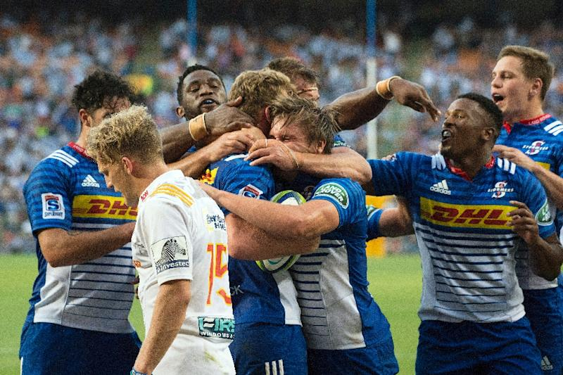 Stormers' South African fly-half Robert du Preez celebrates with his teammates after scoring a try against the New Zealand Waikato Chiefs on April 8, 2017 in Cape Town (AFP Photo/RODGER BOSCH)