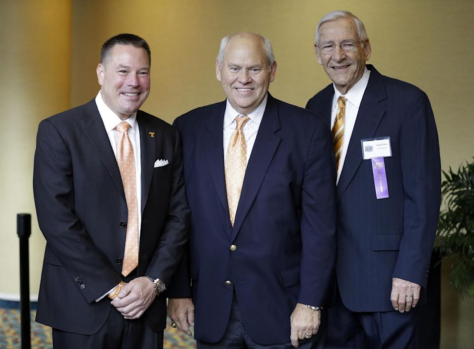 Phil Fulmer (center) will be tasked with finding the replacement for Butch Jones (L). (AP Photo/Mark Humphrey)