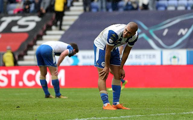 "Soccer Football - League One - Wigan Athletic v AFC Wimbledon - DW Stadium, Wigan, Britain - April 28, 2018 Wigan Athletic's James Vaughan reacts at the end of the game Action Images/John Clifton EDITORIAL USE ONLY. No use with unauthorized audio, video, data, fixture lists, club/league logos or ""live"" services. Online in-match use limited to 75 images, no video emulation. No use in betting, games or single club/league/player publications. Please contact your account representative for further details."