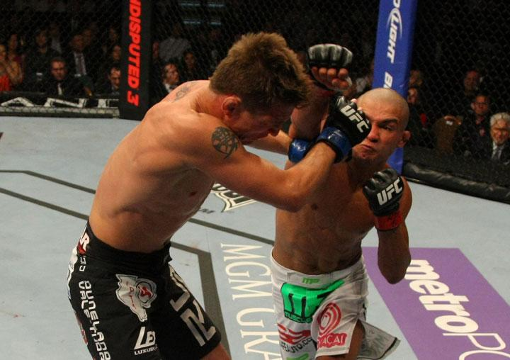 LAS VEGAS, NV - MAY 26:  Diego Brandao (R) punches Darren Elkins during a featherweight bout at UFC 146 at MGM Grand Garden Arena on May 26, 2012 in Las Vegas, Nevada.