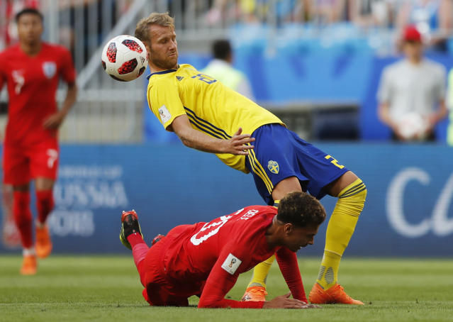 <p>Sweden's Ola Toivonen, above, vies for the ball with England's Dele Alli </p>