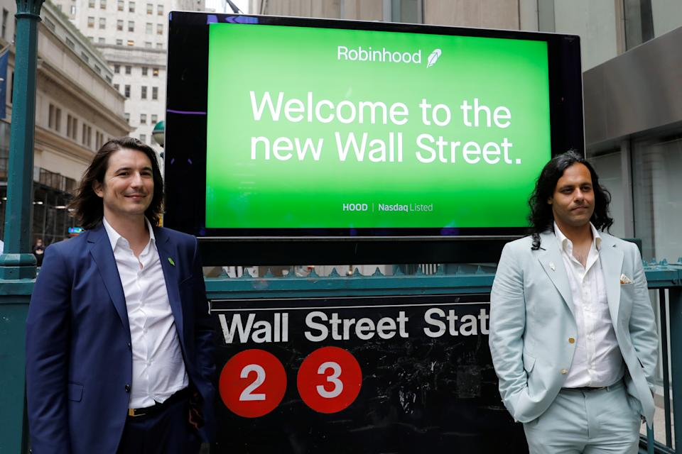 Robinhood Markets, Inc. CEO and co-founder Vlad Tenev and co-founder Baiju Bhatt pose with Robinhood signage on Wall Street after the company's IPO in New York City, U.S., July 29, 2021.  REUTERS/Andrew Kelly