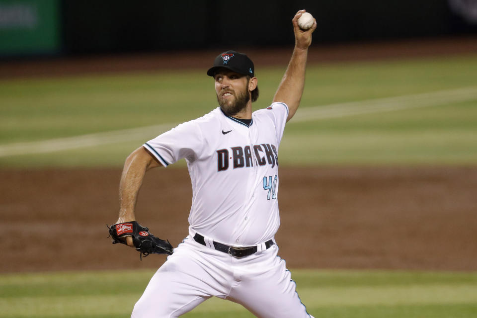 Arizona Diamondbacks starting pitcher Madison Bumgarner (40) throws against the Houston Astros during the third inning of a baseball game Tuesday, Aug. 4, 2020, in Phoenix. (AP Photo/Matt York)