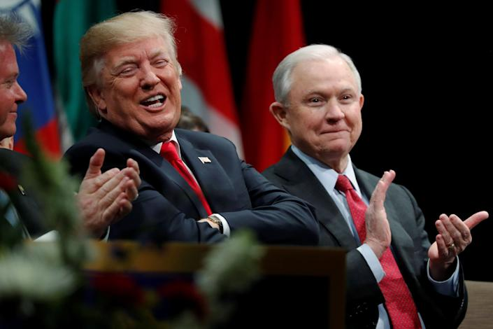 President Donald Trump with Attorney General Jeff Sessions at a graduation ceremony at the FBI Academy in Quantico, Virginia, on Dec. 15. (Photo: Jonathan Ernst / Reuters)