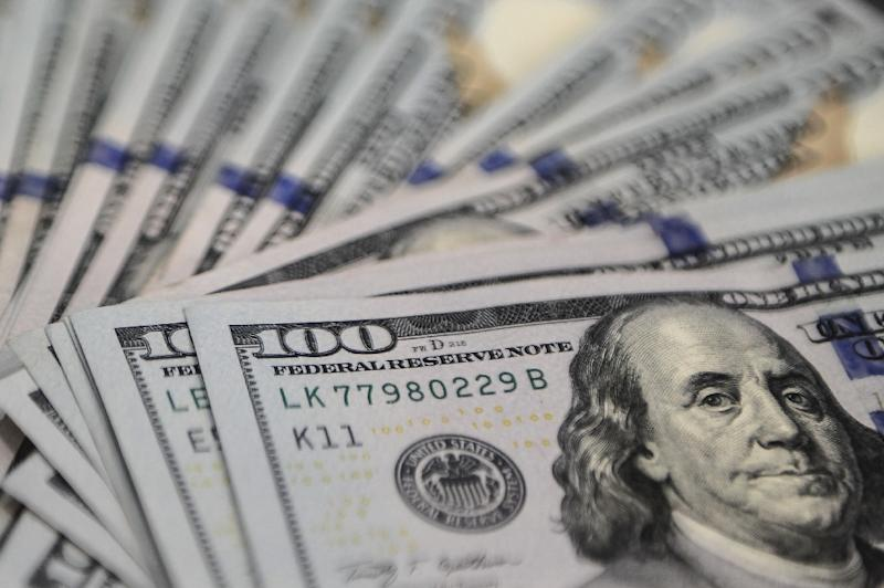 Adding to woes of the global economy is the just-begun program of interest rate increases in the United States, which has strengthened the dollar and raised borrowing costs for emerging market and poorer countries and their corporate sectors (AFP Photo/Mohd Rasfan)