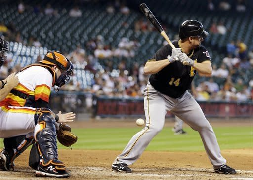 Pittsburgh Pirates' Gaby Sanchez (14) is hit by a pitch with the bases loaded as Houston Astros catcher Chris Snyder, left, reaches for the ball during the fifth inning of a baseball game, Sunday, Sept. 23, 2012, in Houston. (AP Photo/David J. Phillip)