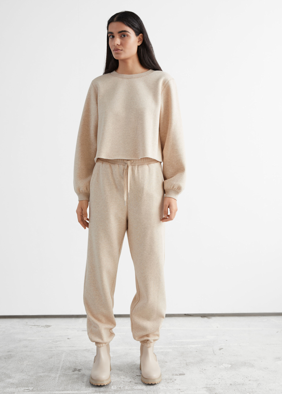 "<h3>& Other Stories</h3><br>This go-to store for floaty dresses and feminine knits has now hopped on the loungewear train. Get them while you still can, they're selling out quick!<br><br><em>Shop </em><strong><em><a href=""https://www.stories.com/"" rel=""nofollow noopener"" target=""_blank"" data-ylk=""slk:& Other Stories"" class=""link rapid-noclick-resp"">& Other Stories</a></em></strong><br><br><strong>& Other Stories</strong> Relaxed Drawstring Trousers, $, available at <a href=""https://go.skimresources.com/?id=30283X879131&url=https%3A%2F%2Fwww.stories.com%2Fen_usd%2Fclothing%2Ftrousers%2Fproduct.relaxed-drawstring-trousers-beige.0929103003.html"" rel=""nofollow noopener"" target=""_blank"" data-ylk=""slk:& Other Stories"" class=""link rapid-noclick-resp"">& Other Stories</a><br><br><strong>& Other Stories</strong> Boxy Jersey Sweater, $, available at <a href=""https://go.skimresources.com/?id=30283X879131&url=https%3A%2F%2Fwww.stories.com%2Fen_usd%2Fclothing%2Ftops%2Fsweatshirts-hoodies%2Fproduct.boxy-jersey-sweater-beige.0929102003.html"" rel=""nofollow noopener"" target=""_blank"" data-ylk=""slk:& Other Stories"" class=""link rapid-noclick-resp"">& Other Stories</a>"