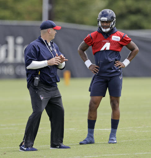 Houston Texans coach Bill O'Brien, left, works with quarterback Deshaun Watson (4) during the team's NFL football minicamp Wednesday, June 13, 2018, in Houston. (AP Photo/David J. Phillip)