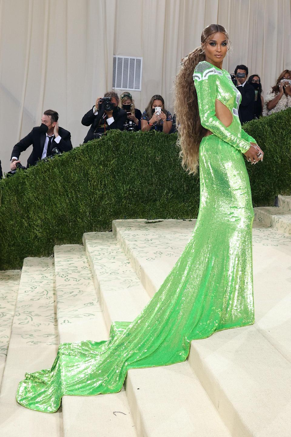 It doesn't get more American than football. Singer Ciara arrived wearing a lime sequin Peter Dundas dress inspired by her husband's team, the Seahawks.