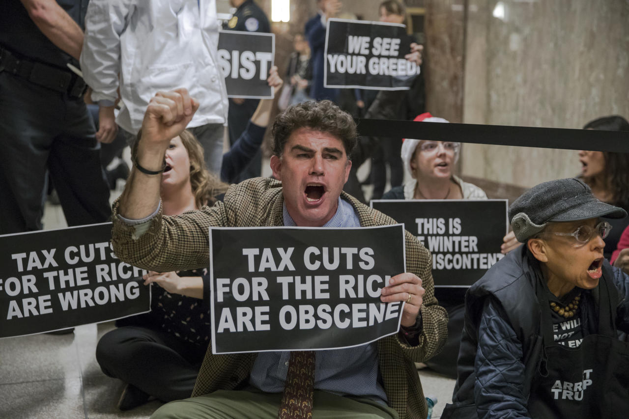 <p>Protesters shout their disapproval of the Republican tax bill outside the Senate Budget Committee hearing room on Capitol Hill in Washington, Tuesday, Nov. 28, 2017. (Photo: J. Scott Applewhite/AP) </p>