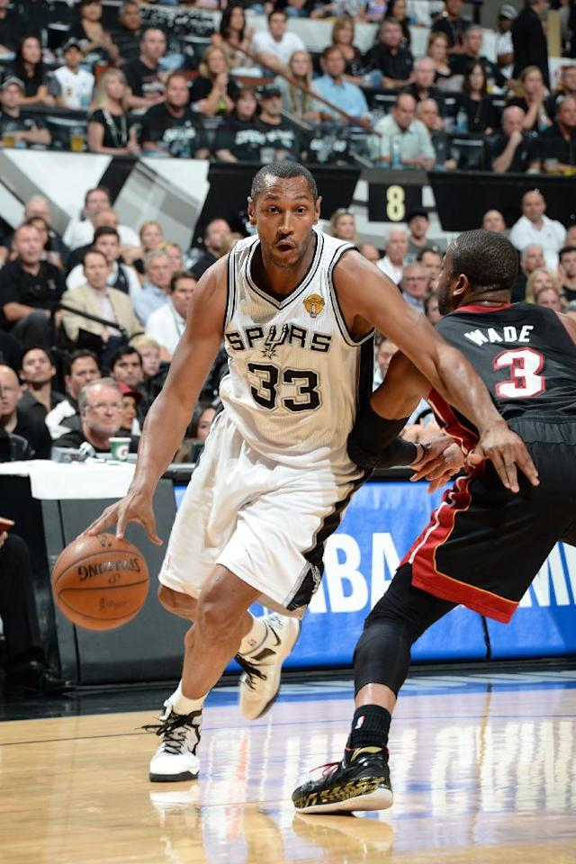 SAN ANTONIO, TX - JUNE 15: Boris Diaw #33 of the San Antonio Spurs drives to the basket against the Miami Heat during Game Five of the 2014 NBA Finals between the Miami Heat and San Antonio Spurs at AT&T Center on June 15, 2014 in San Antonio, Texas. (Photo by Andrew D Bernstein/NBAE via Getty Images)