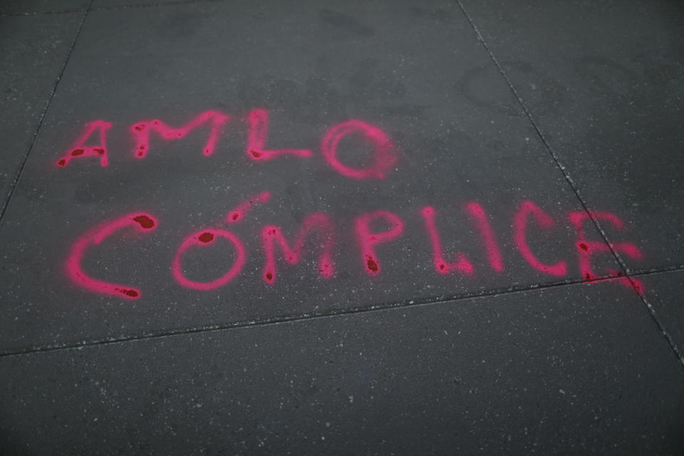 "FILE - In this Feb. 15, 2021 file photo, the Spanish graffiti message ""AMLO is complicit"" is written on the ground outside the National Palace, as a women's collective protests against support by the ruling Morena party, led by Mexican President Andres Manual Lopez Obrador, known familiarly as AMLO, for gubernatorial candidate Felix Salgado Macedonio in Mexico City. Citing multiple accusations of rape and sexual assault against Salgado, the ""Not one aggressor in power"" feminist collective is protesting Salgado's candidature and the ruling Morena party for backing him. (AP Photo/Rebecca Blackwell, File)"