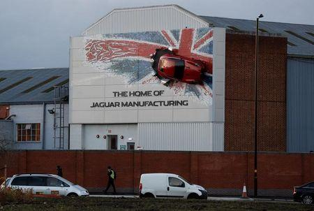 A car hangs on the wall of Jaguar's Castle Bromwich manufacturing facility in Birmingham, Britain, November 17, 2016.  REUTERS/Darren Staples